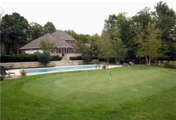 Home with a golf putting green