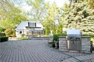 Amazing paved backyard with BBQ
