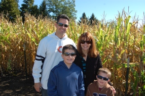 Amy and her family enjoying a Fall festival.